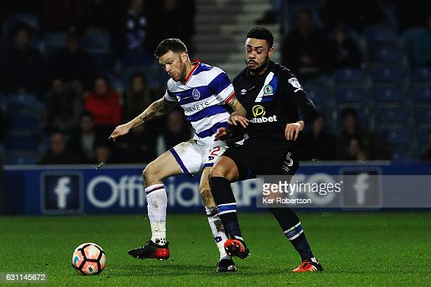 Jamie Mackie of Queens Park Rangers holds off the challenge of Derrick Williams of Blackburn Rovers during the Emirates FA Cup Third Round match...