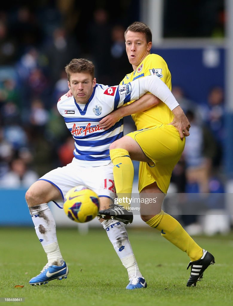 Jamie Mackie of Queens Park Rangers is challenged by <a gi-track='captionPersonalityLinkClicked' href=/galleries/search?phrase=Nicky+Shorey&family=editorial&specificpeople=786022 ng-click='$event.stopPropagation()'>Nicky Shorey</a> of Reading during the Barclays Premier League match between Queens Park Rangers and Reading at Loftus Road on November 4, 2012 in London, England.