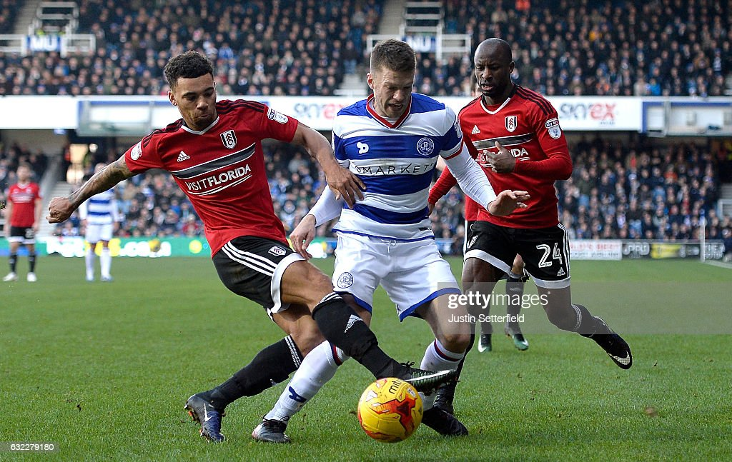 Jamie Mackie of Queens Park Rangers (C) is fouled by Scott Malone of Fulham FC (L) during the Sky Bet Championship match between Queens Park Rangers and Fulham at Loftus Road on January 21, 2017 in London, England.