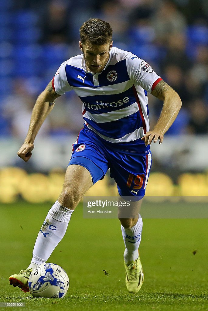 <a gi-track='captionPersonalityLinkClicked' href=/galleries/search?phrase=Jamie+Mackie&family=editorial&specificpeople=5545546 ng-click='$event.stopPropagation()'>Jamie Mackie</a> of Reading in action during the Sky Bet Championship match between Reading and Millwall at Madejski Stadium on September 16, 2014 in Reading, England.