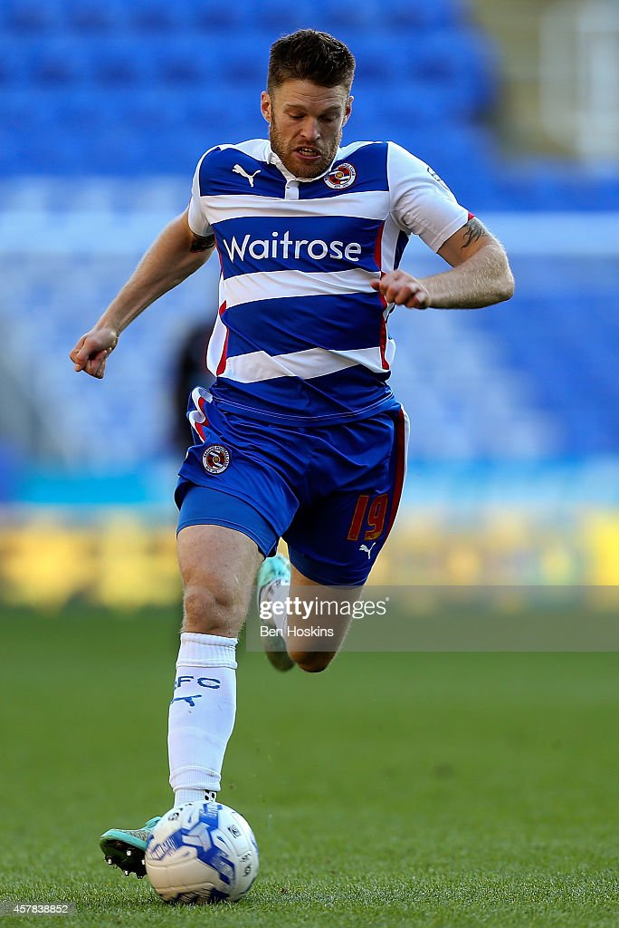<a gi-track='captionPersonalityLinkClicked' href=/galleries/search?phrase=Jamie+Mackie&family=editorial&specificpeople=5545546 ng-click='$event.stopPropagation()'>Jamie Mackie</a> of Reading in action during the Sky Bet Championship match between Reading and Blackpool at Madejski Stadium on October 25, 2014 in Reading, England.