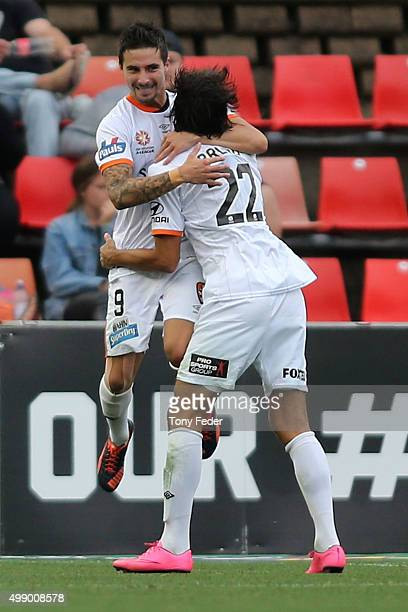 Jamie Maclaren and Thomas Broich of the Roar celebrate a goal during the round eight ALeague match between the Newcastle Jets and Brisbane Roar at...