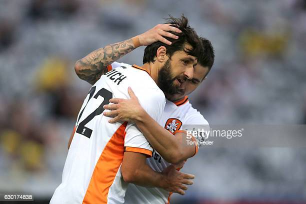 Jamie Maclaren and Thomas Broich of the Roar celebrate a goal during the round 11 ALeague match between the Central Coast Mariners and Brisbane Roar...
