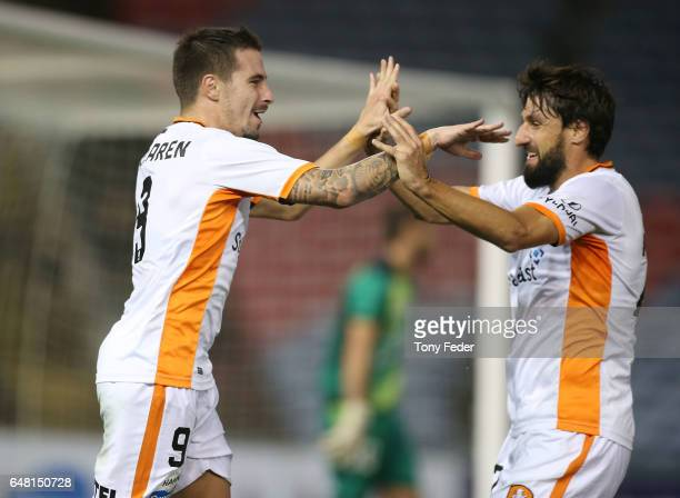 Jamie Maclaren and Thomas Broich of the Roar celebrate a goal during the round 22 ALeague match between the Newcastle Jets and the Brisbane Roar at...