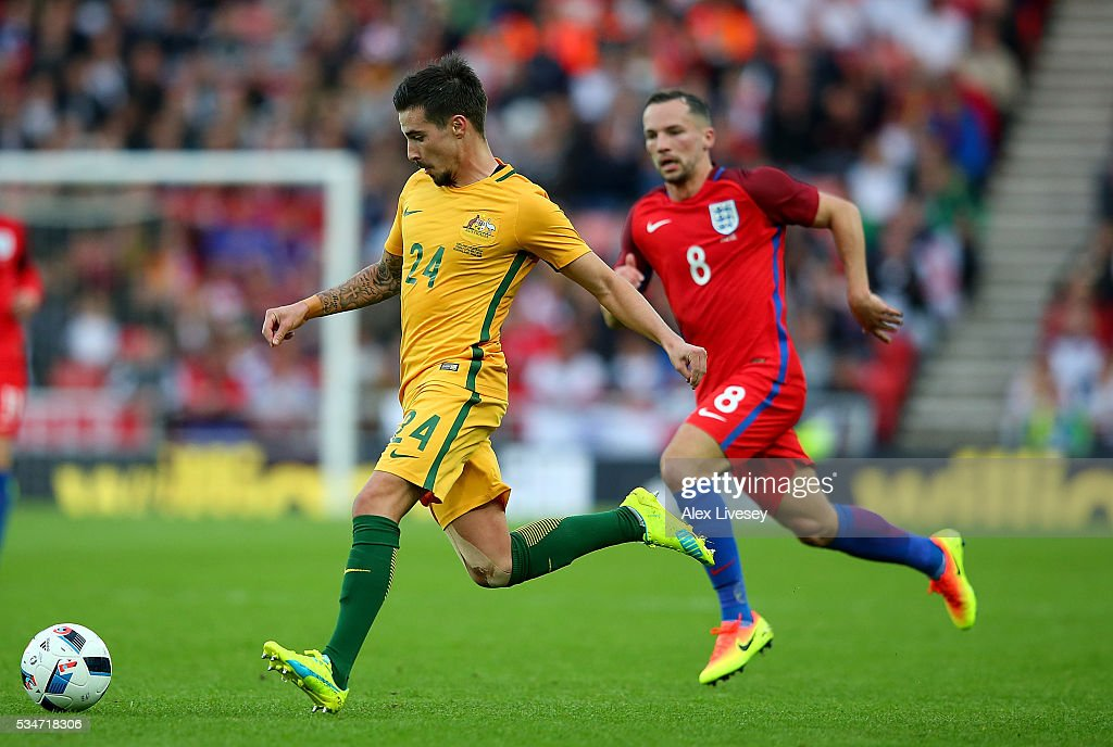Jamie Maclaren of Australia advances under pressure from Danny Drinkwater of England during the International Friendly match between England and Australia at Stadium of Light on May 27, 2016 in Sunderland, England.