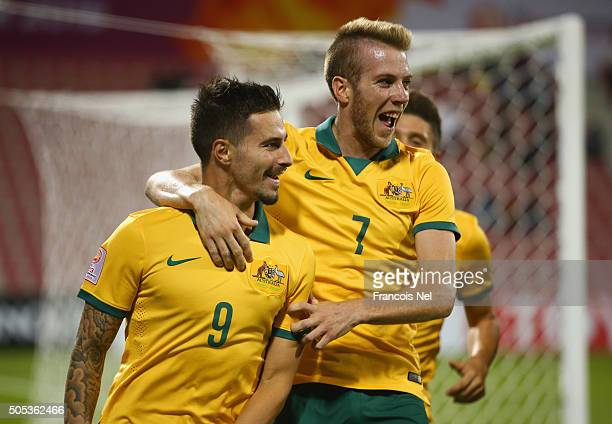 Jamie Maclaren of Australia celebrates with team mate Andrew Hoole as he scores their second goal during the AFC U23 Championship Group D match...