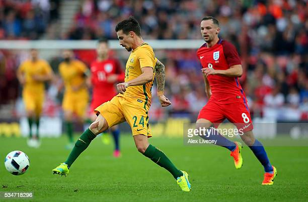 Jamie Maclaren of Australia passes under pressure from Danny Drinkwater of England during the International Friendly match between England and...