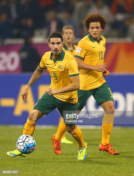 Jamie Maclaren of Australia runs with the ball next to teammate Mustafa Amini of Australia during the AFC U23 Championship Group D match between...