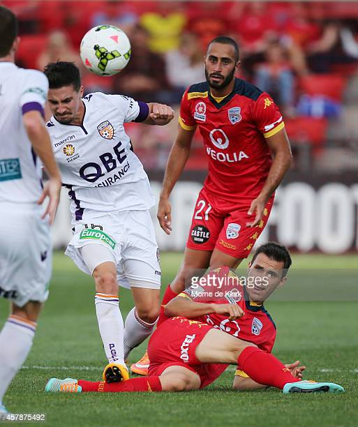 Jamie Maclaren of Perth Glory steps on the leg of Isaias of Adelaide United during the round three ALeague match between Adelaide United and the...