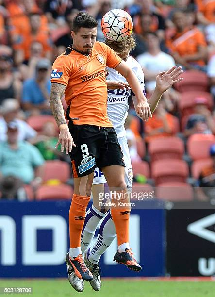 Jamie Maclaren of the Roar and Michael Thwaite of the Glory compete for the ball during the round 13 ALeague match between the Brisbane Roar and the...