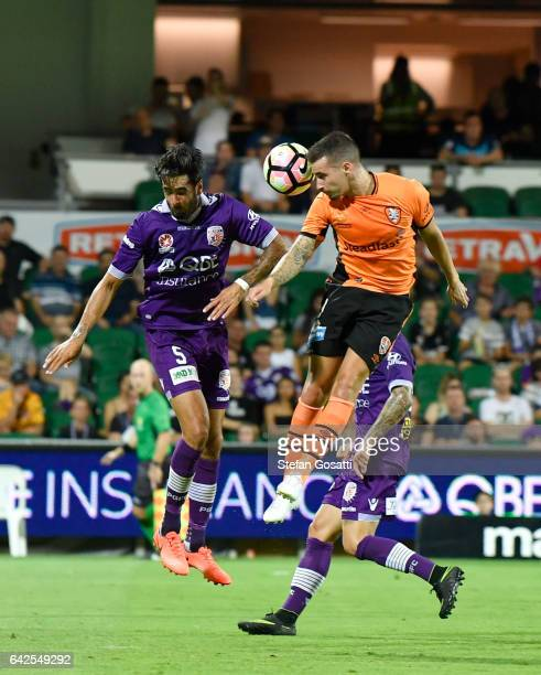 Jamie Maclaren of the Roar and Rhys Williams of the Glory contast the ball during the round 20 ALeague match between Perth Glory and Brisbane Roar at...