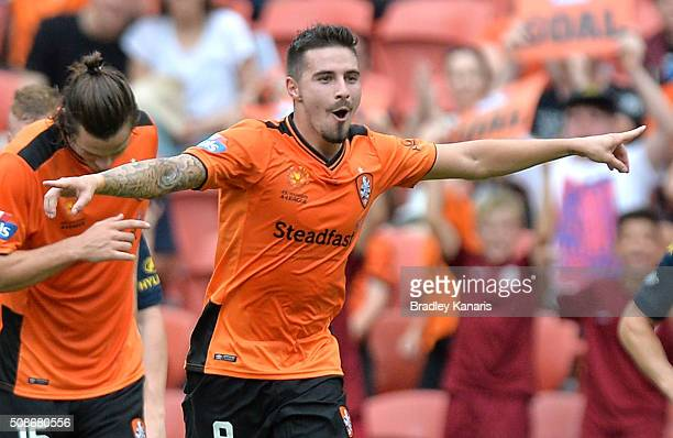Jamie Maclaren of the Roar celebrates scoring a goal during the round 18 ALeague match between the Brisbane Roar and Central Coast Mariners at...