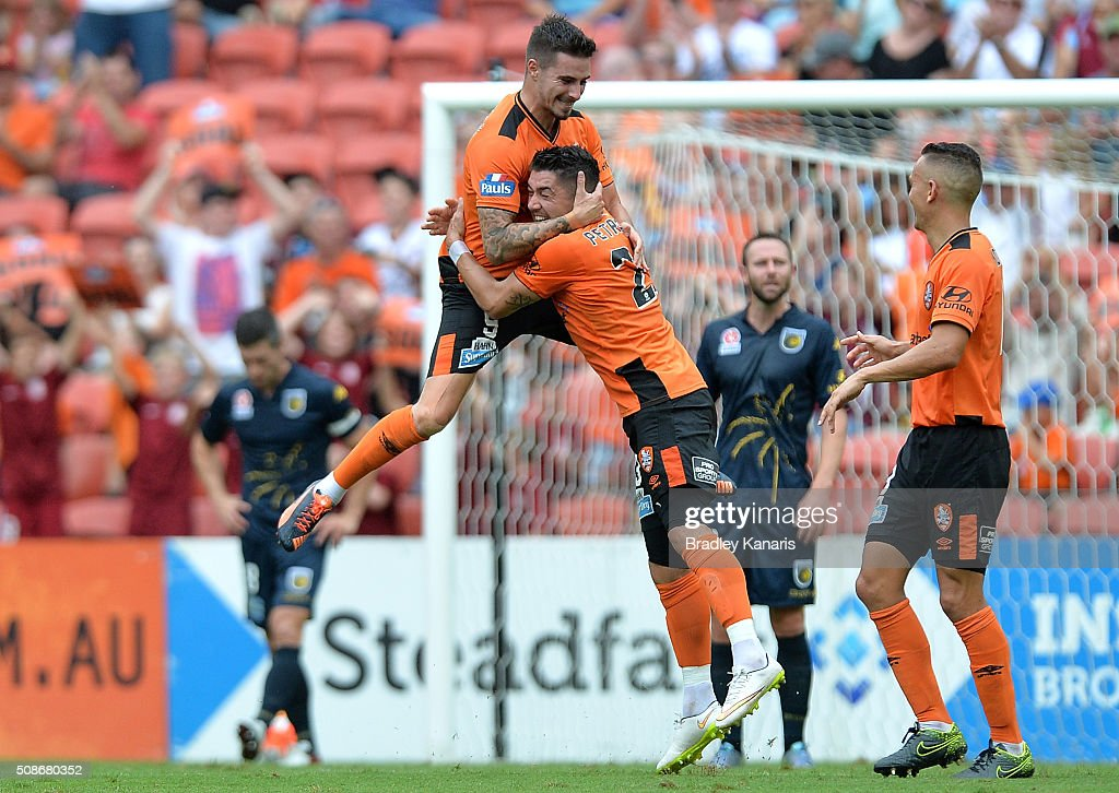 <a gi-track='captionPersonalityLinkClicked' href=/galleries/search?phrase=Jamie+Maclaren&family=editorial&specificpeople=10952889 ng-click='$event.stopPropagation()'>Jamie Maclaren</a> of the Roar celebrates with team mate Dimitri Petratos after scoring a goal during the round 18 A-League match between the Brisbane Roar and Central Coast Mariners at Suncorp Stadium on February 6, 2016 in Brisbane, Australia.