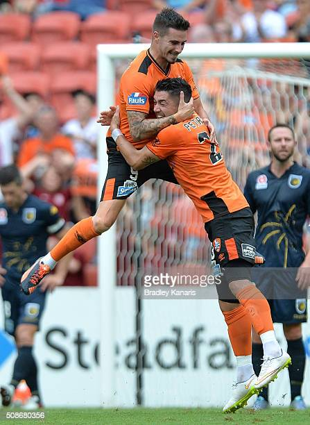 Jamie Maclaren of the Roar celebrates with team mate Dimitri Petratos after scoring a goal during the round 18 ALeague match between the Brisbane...