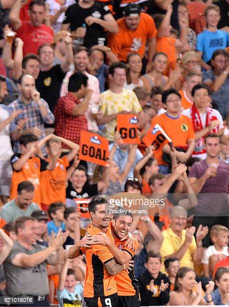 Jamie Maclaren of the Roar celebrates with Tommy Oar after scoring a goal during the round five ALeague match between the Brisbane Roar and Melbourne...