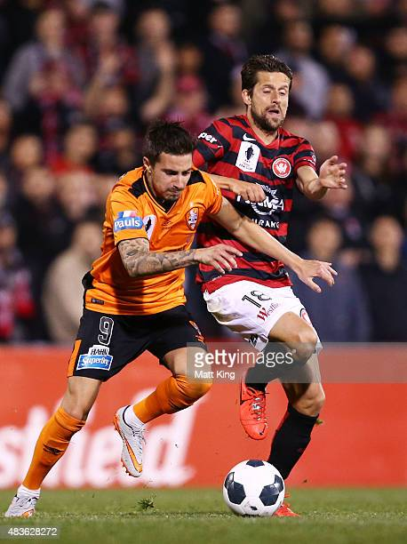 Jamie Maclaren of the Roar is challenged by Andreu Guerao of the Wanderers during the FFA Cup match between Western Sydney Wanderers and Brisbane...