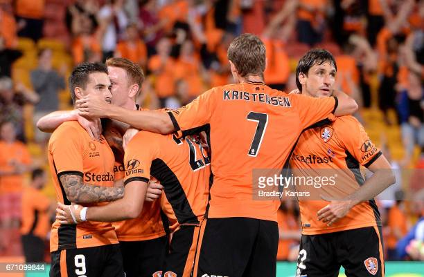 Jamie Maclaren of the Roar is congratulated by team mates after scoring a goal during the ALeague Elimination Final match between the Brisbane Roar...