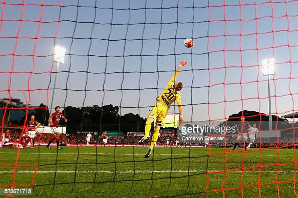 Jamie Maclaren of the Roar scores a goal past Wanderers goalkeeper Andrew Redmayne during the ALeague Semi Final match between the Western Sydney...