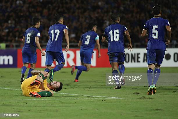 Jamie Maclaren of the Socceroos grimaces as he holds his leg after a heavy tackle during the 2018 FIFA World Cup Qualifier match between Thailand and...