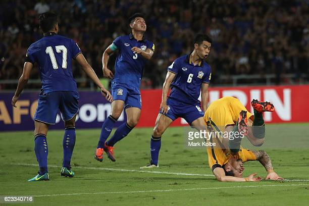 Jamie Maclaren of the Socceroos lands awkwardly after a heavy tackle during the 2018 FIFA World Cup Qualifier match between Thailand and the...