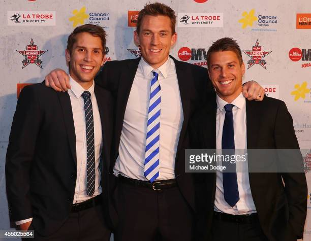 Jamie Macmillan Drew Petrie and Andrew Swallow of the Kangaroos pose at the 2014 AFL Players MVP Awards at Shed 14 on September 9 2014 in Melbourne...