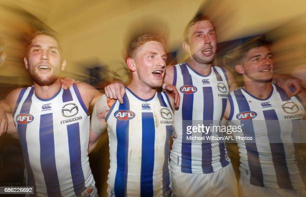 Jamie Macmillan Jack Ziebell Todd Goldstein and Shaun Atley of the Kangaroos sing the team song during the 2017 AFL round 09 match between the...