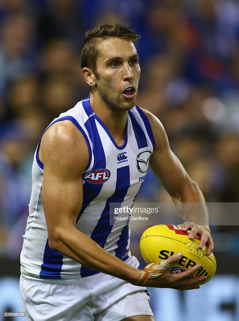 Jamie Macmillan of the Kangaroos controls the ball during the round six AFL match between the North Melbourne Kangaroos and the Western Bulldogs at Etihad Stadium on April 29, 2016 in Melbourne, Australia.