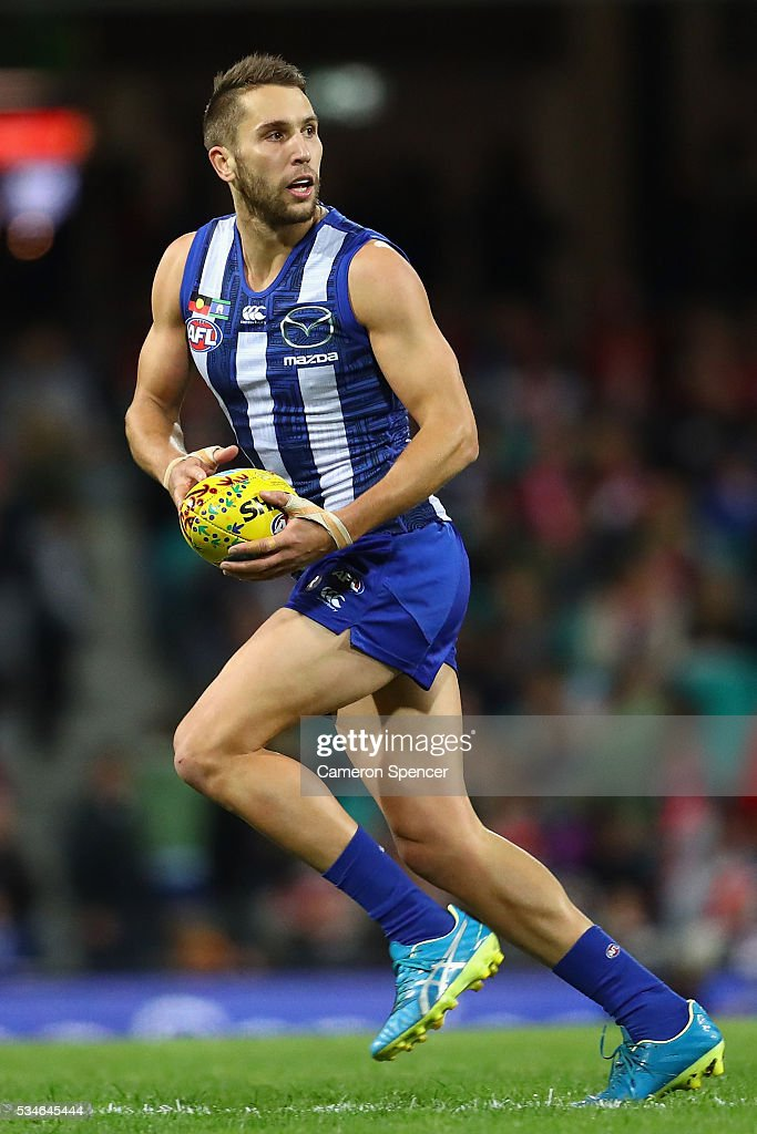 Jamie MacMillan of the Kangaroos runs the ball during the round 10 AFL match between the Sydney Swans and the North Melbourne Kangaroos at Sydney Cricket Ground on May 27, 2016 in Sydney, Australia.