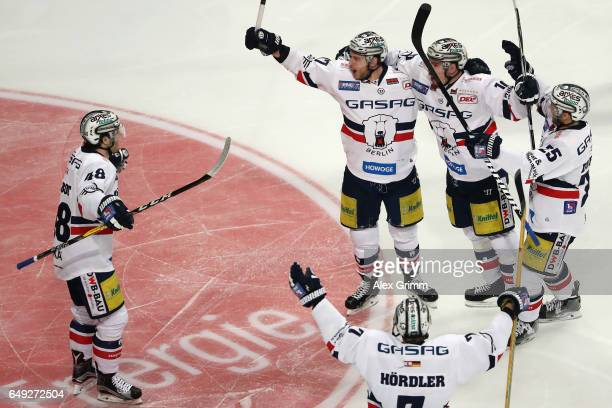 Jamie MacQueen of Berlin celebrates his team's first goal with team mates during the DEL Playoffs quarter finals Game 1 between Adler Mannheim and...
