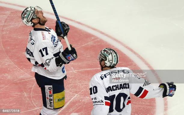 Jamie MacQueen of Berlin celebrates his team's first goal with team mate Spencer Machacek during the DEL Playoffs quarter finals Game 1 between Adler...
