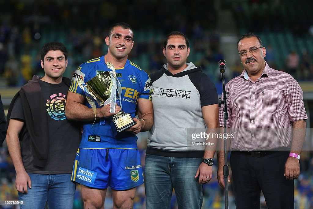 Jamie Mannah, Tim Mannah, Danny Mannah and Fred Mannah pose with the Annual Johnny Mannah cup after the round five NRL match between the Parramatta Eels and the Cronulla Sharks at Parramatta Stadium on April 6, 2013 in Sydney, Australia.