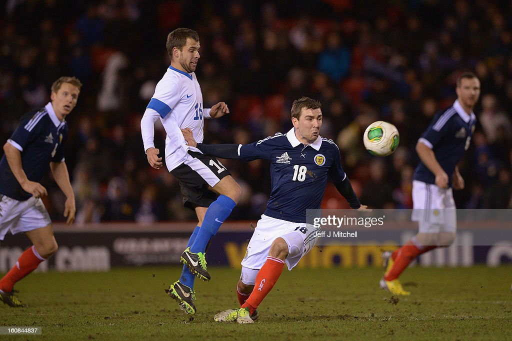 Jamie McArthur of Scotland tackles Sergi Mosnikov of Estonia during the international friendly match between Scotland and Estonia at Pittodrie Stadium on February 6, 2013 in Aberdeen, Scotland.