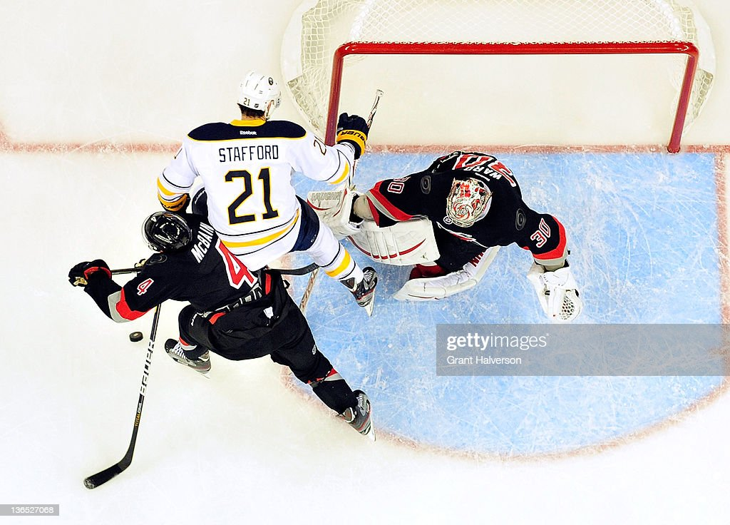 Jamie McBain #4 and <a gi-track='captionPersonalityLinkClicked' href=/galleries/search?phrase=Cam+Ward&family=editorial&specificpeople=453216 ng-click='$event.stopPropagation()'>Cam Ward</a> #30 of the Carolina Hurricanes defend a shot by <a gi-track='captionPersonalityLinkClicked' href=/galleries/search?phrase=Drew+Stafford&family=editorial&specificpeople=220617 ng-click='$event.stopPropagation()'>Drew Stafford</a> #21 of the Buffalo Sabres during play at the RBC Center on January 6, 2012 in Raleigh, North Carolina. The Hurricanes won 4-2.