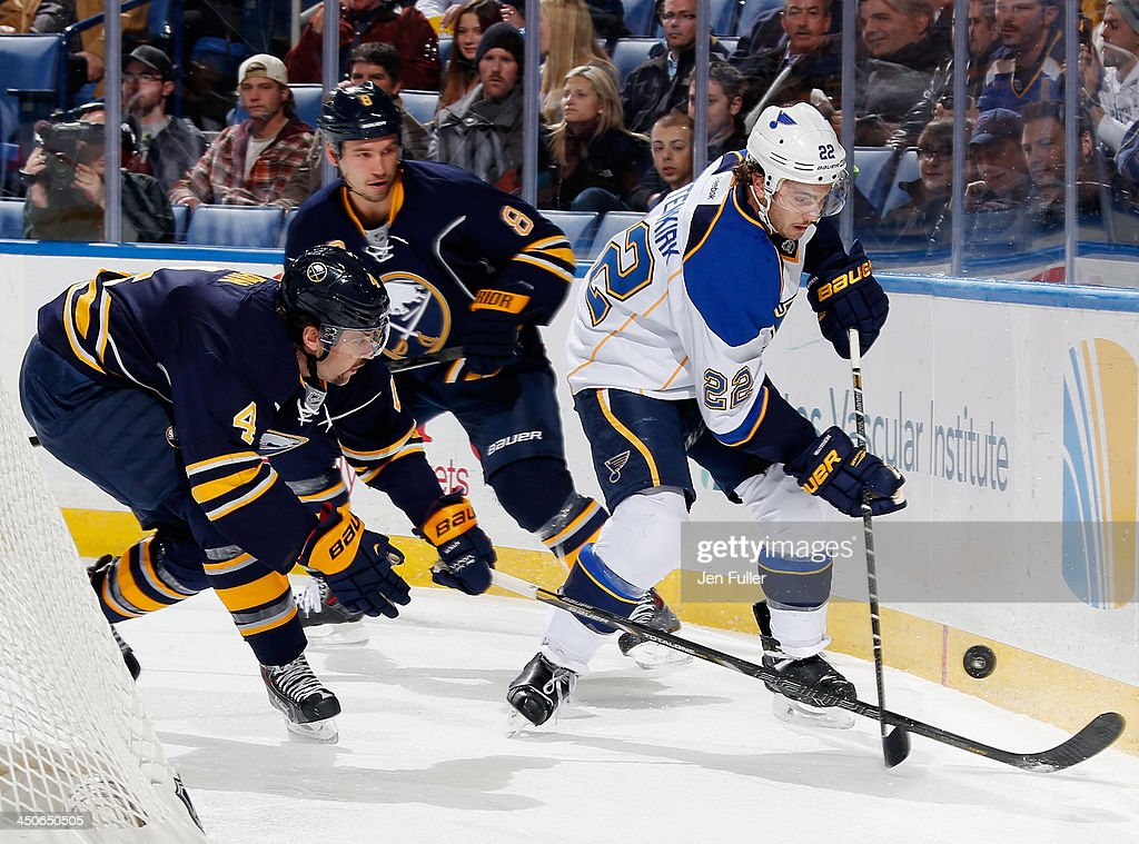 <a gi-track='captionPersonalityLinkClicked' href=/galleries/search?phrase=Jamie+McBain&family=editorial&specificpeople=543199 ng-click='$event.stopPropagation()'>Jamie McBain</a> #4 of the Buffalo Sabres battles with <a gi-track='captionPersonalityLinkClicked' href=/galleries/search?phrase=Kevin+Shattenkirk&family=editorial&specificpeople=4324986 ng-click='$event.stopPropagation()'>Kevin Shattenkirk</a> #22 of the St. Louis Blues for control of the puck as <a gi-track='captionPersonalityLinkClicked' href=/galleries/search?phrase=Cody+McCormick&family=editorial&specificpeople=213546 ng-click='$event.stopPropagation()'>Cody McCormick</a> #8 of the Sabres ollows the play at First Niagara Center on November 19, 2013 in Buffalo, New York. St. Louis defeated Buffalo 4-1.