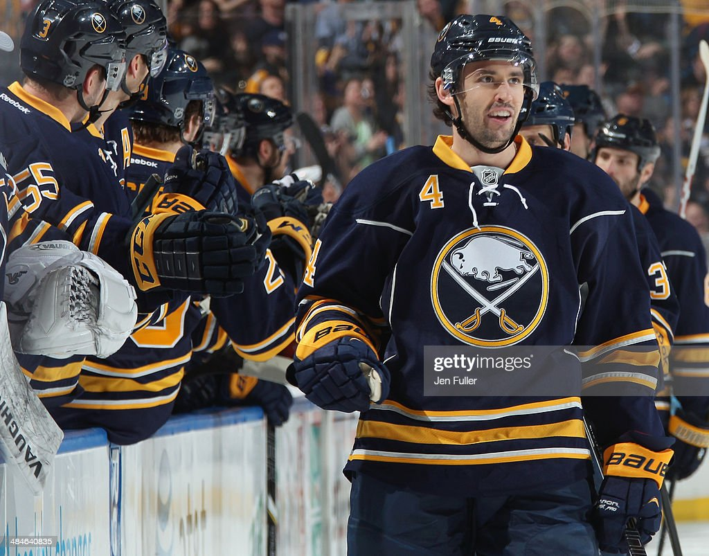 Jamie McBain of the Buffalo Sabres celebrates his first period goal against the New York Islanders at First Niagara Center on April 13 2014 in...