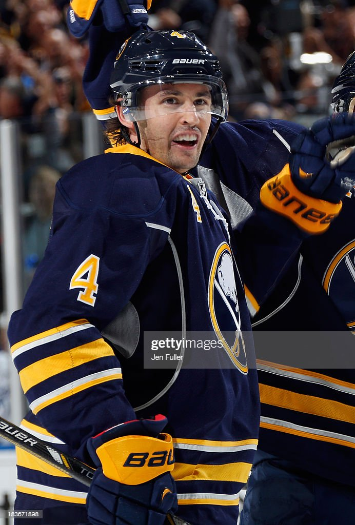 <a gi-track='captionPersonalityLinkClicked' href=/galleries/search?phrase=Jamie+McBain&family=editorial&specificpeople=543199 ng-click='$event.stopPropagation()'>Jamie McBain</a> #4 of the Buffalo Sabres celebrates his second period goal against the Tampa Bay Lightning at First Niagara Center on October 8, 2013 in Buffalo, New York. Tampa defeated Buffalo 3-2.
