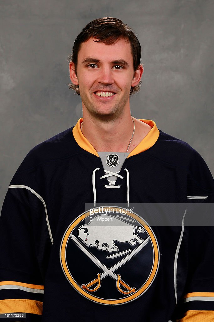 Jamie McBain of the Buffalo Sabres poses for his official headshot for the 20132014 season on September 11 2013 at the First Niagara Center in...