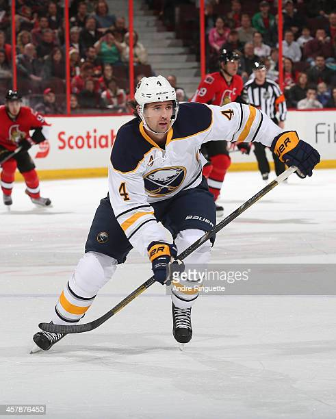 Jamie McBain of the Buffalo Sabres skates against the Ottawa Senators at Canadian Tire Centre on December 12 2013 in Ottawa Ontario Canada
