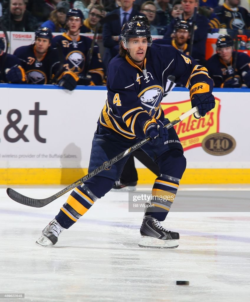 Jamie McBain of the Buffalo Sabres skates against the Winnipeg Jets on December 17 2013 at the First Niagara Center in Buffalo New York