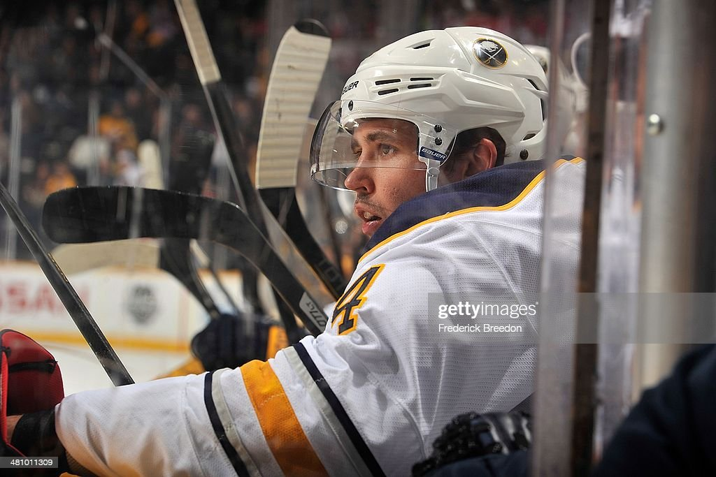 Jamie McBain of the Buffalo Sabres watches from the bench during a game against the Nashville Predators at Bridgestone Arena on March 27 2014 in...
