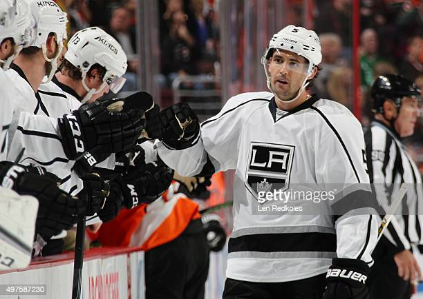 Jamie McBain of the Los Angeles Kings celebrates his first period powerplay goal against the Philadelphia Flyers with his teammates on the bench on...