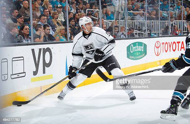 Jamie McBain of the Los Angeles Kings controls the puck against the San Jose Sharks at SAP Center on October 22 2015 in San Jose California
