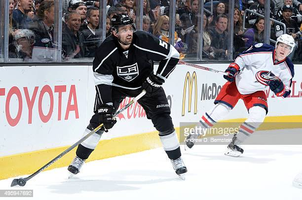 Jamie McBain of the Los Angeles Kings handles the puck against Matt Calvert of the Columbus Blue Jackets at STAPLES Center on November 05 2015 in Los...
