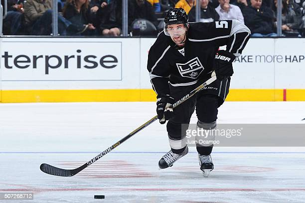 Jamie McBain of the Los Angeles Kings passes the puck during the game against the Minnesota Wild on January 21 2016 at Staples Center in Los Angeles...
