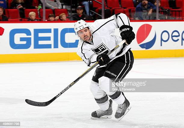Jamie McBain of the Los Angeles Kings skates for position on the ice during an NHL game against the Carolina Hurricanes at PNC Arena on November 22...