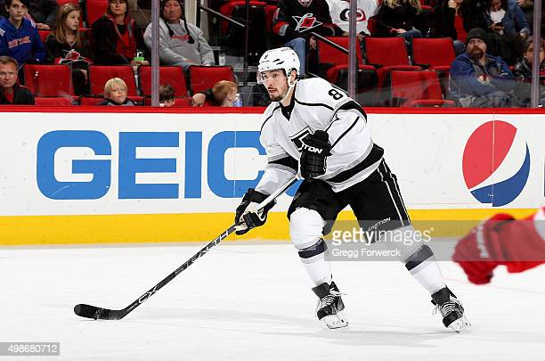 Jamie McBain of the Los Angeles Kings skates with the puck during an NHL game against the Carolina Hurricanes at PNC Arena on November 22 2015 in...