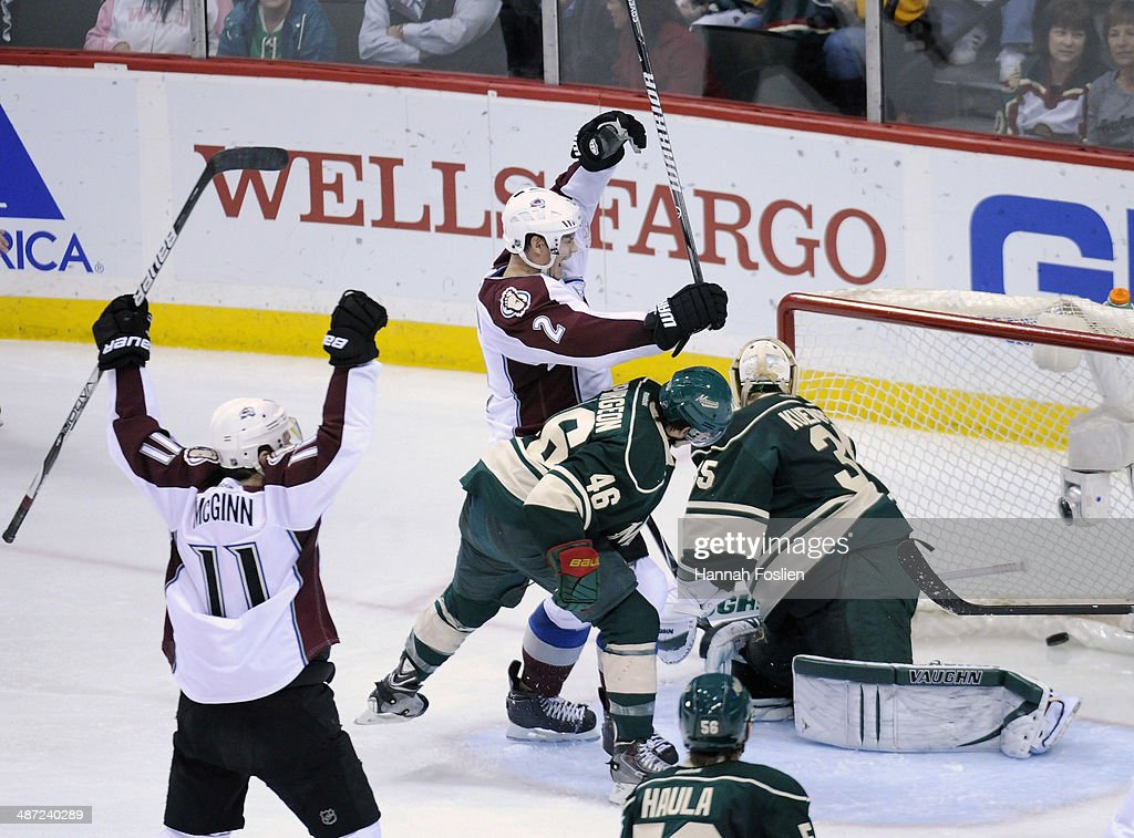 Jamie McGinn #11 and Nick Holden #2 of the Colorado Avalanche celebrate a goal by Holden as Jared Spurgeon #46 and Darcy Kuemper #35 of the Minnesota Wild look on during the second period in Game Six of the First Round of the 2014 NHL Stanley Cup Playoffs on April 28, 2014 at Xcel Energy Center in St Paul, Minnesota.