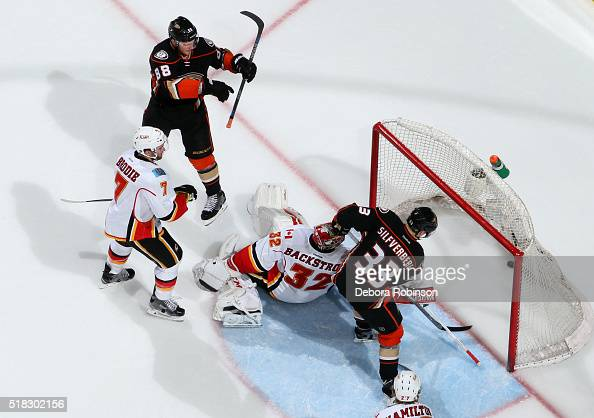 Jamie McGinn celebrates as Jakob Silfverberg of the Anaheim Ducks scores in the third period against Niklas Backstrom and TJ Brodie of the Calgary...