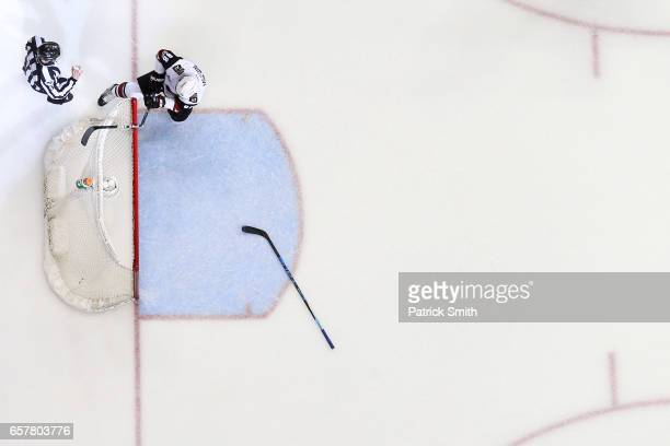 Jamie McGinn of the Arizona Coyotes breaks his stick over the crossbar after Daniel Winnik of the Washington Capitals scored an empty net goal during...