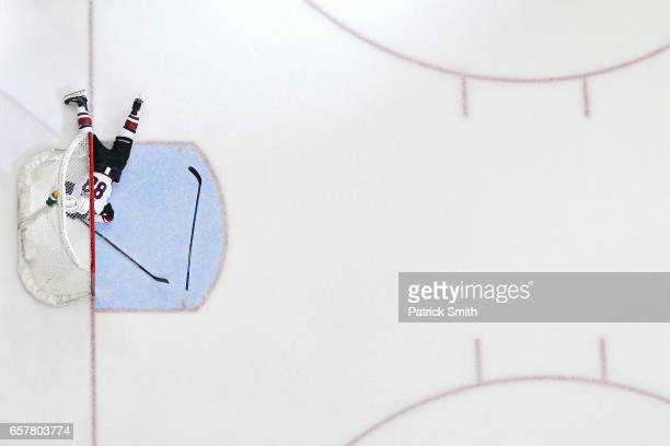 Jamie McGinn of the Arizona Coyotes lays on the ice after Daniel Winnik of the Washington Capitals scored an empty net goal during the third period...